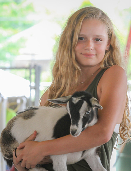 Girl holding a goat