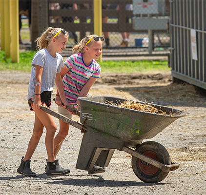 Girls with wheelbarrow