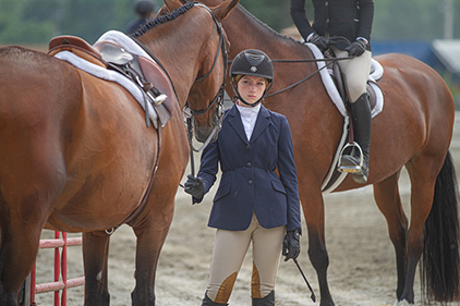 Girl at a Horse Show